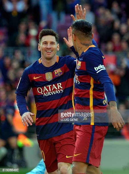 Barcelona's Argentinian forward Lionel Messi and Barcelona's Brazilian forward Neymar celebrate an Getafe's own goal during the Spanish league...