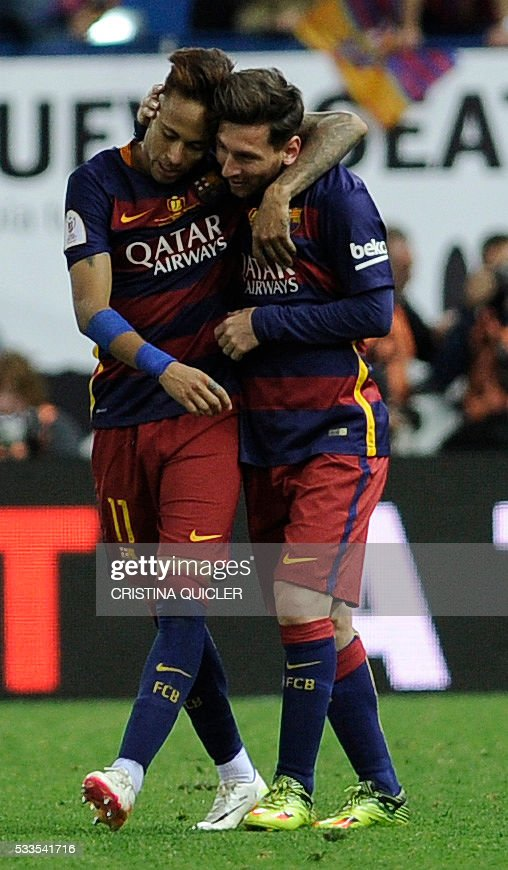 Barcelona's Argentinian forward Lionel Messi (R) and Barcelona's Brazilian forward Neymar embrace at the end of the Spanish 'Copa del Rey' (King's Cup) final match FC Barcelona vs Sevilla FC at the Vicente Calderon stadium in Madrid on May 22, 2016. / AFP / CRISTINA