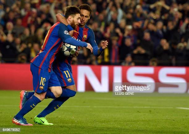 Barcelona's Argentinian forward Lionel Messi and Barcelona's Brazilian forward Neymar celebrate a goal during the UEFA Champions League round of 16...