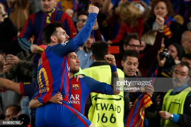 Barcelona's Argentinian forward Lionel Messi and Barcelona's Brazilian forward Neymar celebrate their last goal during the UEFA Champions League...