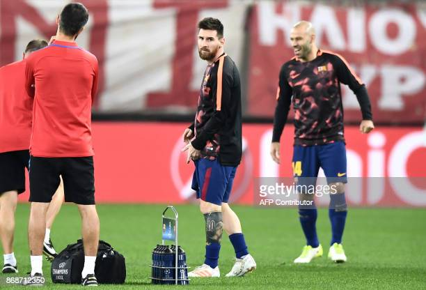 Barcelona's Argentinian forward Lionel Messi and Barcelona's Argentinian defender Javier Mascherano warm up prior to the UEFA Champions League group...