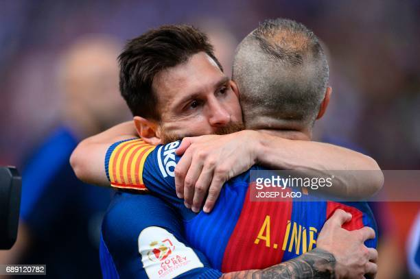 Barcelona's Argentinian forward Lionel Messi and Barcelona's midfielder Andres Iniesta congratulate eachother at the end of the Spanish Copa del Rey...