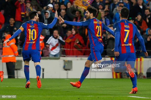 Barcelona's Argentinian forward Lionel Messi and Barcelona's Portuguese midfielder Andre Gomes celebrate after Barcelona scored the opener during the...