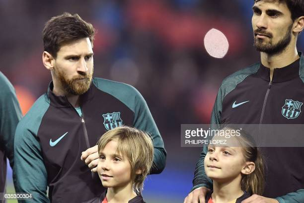 Barcelona's Argentinian forward Lionel Messi and Barcelona's Portuguese midfielder Andre Gomes pose prior to the UEFA Champions League round of 16...