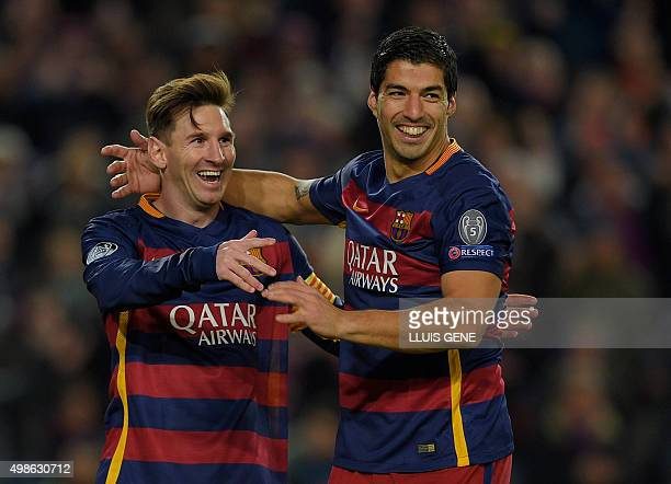 Barcelona's Argentinian forward Lionel Messi and Barcelona's Uruguayan forward Luis Suarez celebrate their fourth goal during the UEFA Champions...