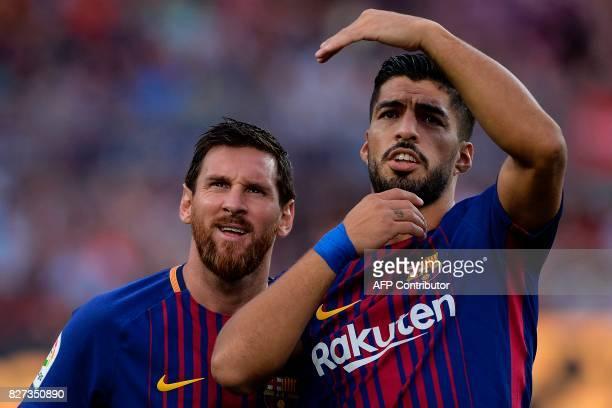 TOPSHOT Barcelona's Argentinian forward Lionel Messi and Barcelona's Uruguayan forward Luis Suarez look on during the 52nd Joan Gamper Trophy...