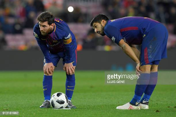 TOPSHOT Barcelona's Argentinian forward Lionel Messi and Barcelona's Uruguayan forward Luis Suarez look on during the Spanish 'Copa del Rey' first...