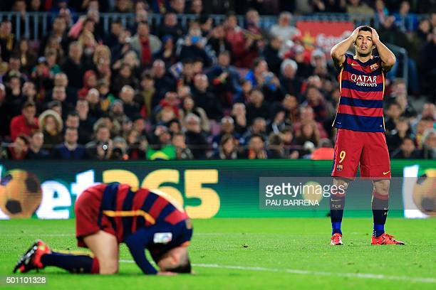 Barcelona's Argentinian forward Lionel Messi and FC Barcelona's Uruguayan forward Luis Suarez gesture after missing a goal during the Spanish league...