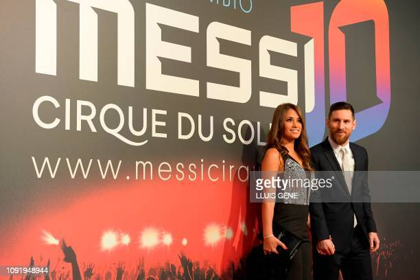 Barcelona's Argentinian forward Lionel Messi and his wife Antonella Roccuzzo pose on the red carpet during a photocall for Cirque du Soleil's latest...