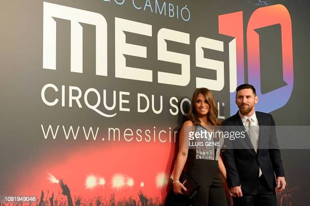 TOPSHOT Barcelona's Argentinian forward Lionel Messi and his wife Antonella Roccuzzo pose on the red carpet during a photocall for Cirque du Soleil's...
