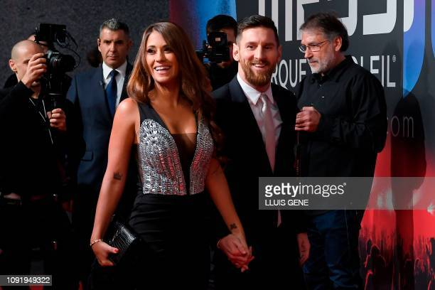 Barcelona's Argentinian forward Lionel Messi and his wife Antonella Roccuzzo arrive for a photocall for Cirque du Soleil's latest show Messi 10...