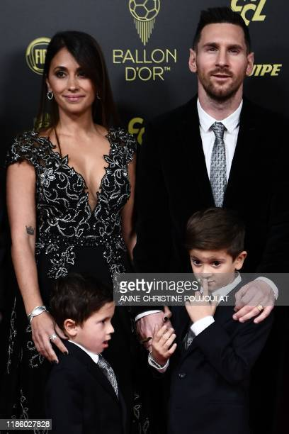 TOPSHOT Barcelona's Argentinian forward Lionel Messi and his wife Antonella Roccuzzo and their sons Thiago and Mateo arrive to attend the Ballon d'Or...