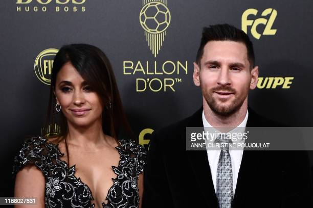Barcelona's Argentinian forward Lionel Messi and his wife Antonella Roccuzzo arrive to attend the Ballon d'Or France Football 2019 ceremony at the...