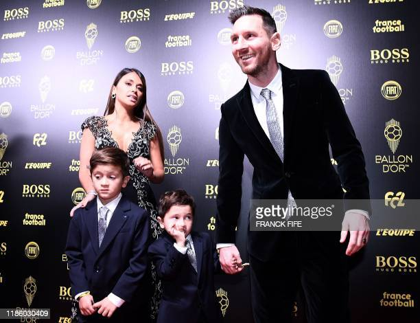 Barcelona's Argentinian forward Lionel Messi and his wife Antonella Roccuzzo and their sons Thiago and Mateo arrive to attend the Ballon d'Or France...