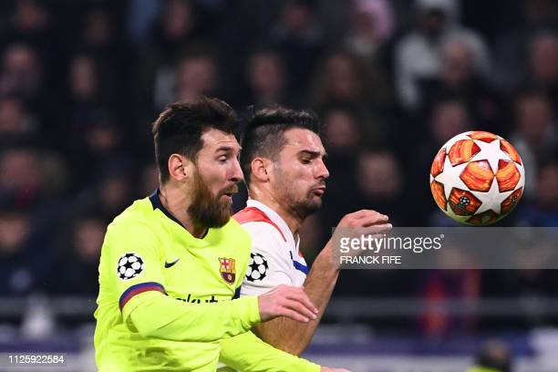 Barcelona's Argentinian forward Lionel Messi and Lyon's French defender Leo Dubois vies for the ball during the UEFA Champions League round of 16...