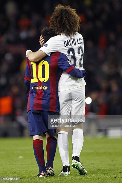 Barcelona's Argentinian forward Lionel Messi and Paris SaintGermain's Brazilian defender David Luiz at the end of the UEFA Champions League Group F...