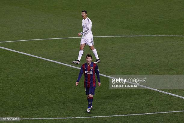 Barcelona's Argentinian forward Lionel Messi and Real Madrid's Portuguese forward Cristiano Ronaldo walk on the field during the 'clasico' Spanish...