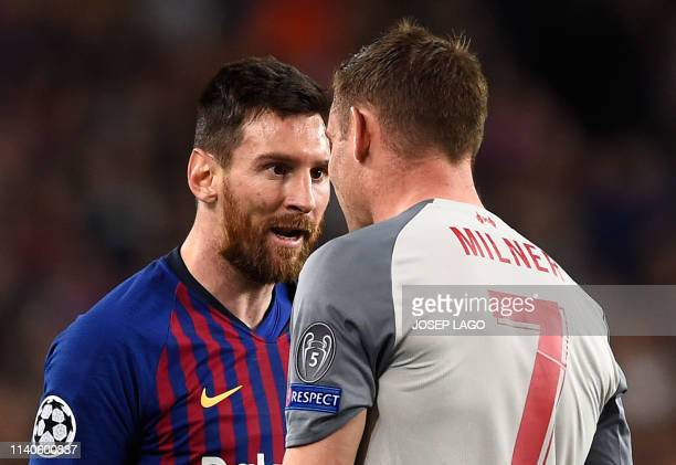 Barcelona's Argentinian forward Lionel Messi argues with Liverpool's English midfielder James Milner during the UEFA Champions League semi-final...