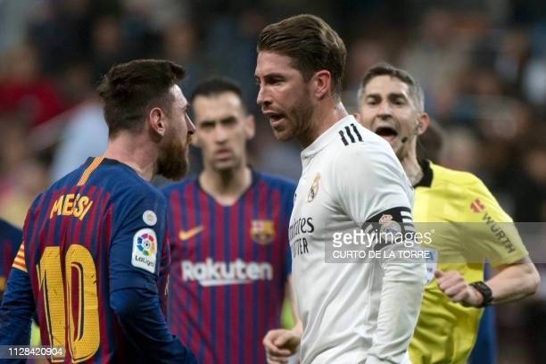 Barcelona's Argentinian forward Lionel Messi argues with Real Madrid's Spanish defender Sergio Ramos during the Spanish league football match between...