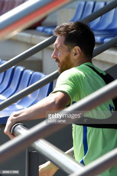 Barcelona's Argentinian forward Lionel Messi arrives to a training session at the Sports Center FC Barcelona Joan Gamper in Sant Joan Despi near...