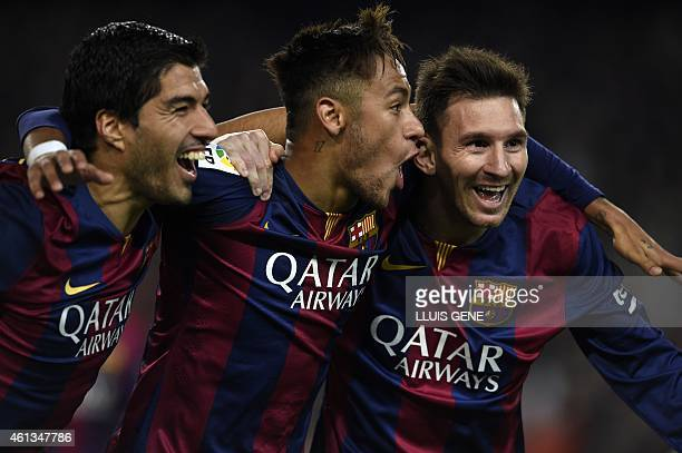 Barcelona's Argentinian forward Lionel Messi Barcelona's Brazilian forward Neymar da Silva Santos Junior and Barcelona's Uruguayan forward Luis...