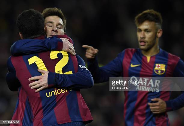 Barcelona's Argentinian forward Lionel Messi , Barcelona's Brazilian forward Neymar da Silva Santos Junior and Barcelona's midfielder Rafinha...