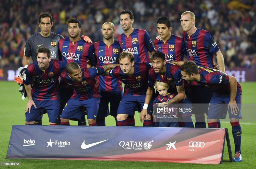 Barcelona's Argentinian forward Lionel Messi, Barcelona's Brazilian defender Dani Alves, Barcelona's Croatian midfielder Ivan Rakitic, Barcelona's Brazilian forward Neymar da Silva Santos Junior and his son, Barcelona's defender Jordi Alba, (from top L) Barcelona's goalkeeper Claudio Bravo, Barcelona's midfielder Rafinha, Barcelona's Argentinian midfielder Javier Mascherano, Barcelona's midfielder Sergio Busquets, Barcelona's Uruguayan forward Luis Suarez and Barcelona's French defender Jeremy Mathieu pose before the Spanish league football match FC Barcelona vs RC Celta de Vigo at the Camp Nou stadium in Barcelona on November 1, 2014.