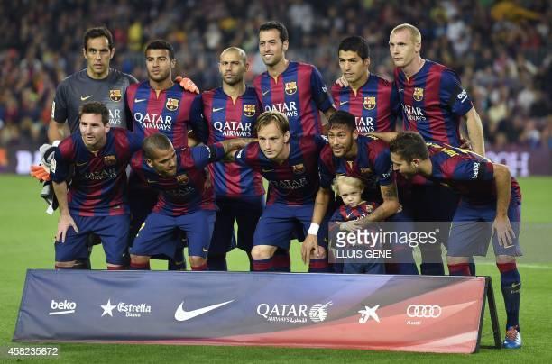 Barcelona's Argentinian forward Lionel Messi, Barcelona's Brazilian defender Dani Alves, Barcelona's Croatian midfielder Ivan Rakitic, Barcelona's...