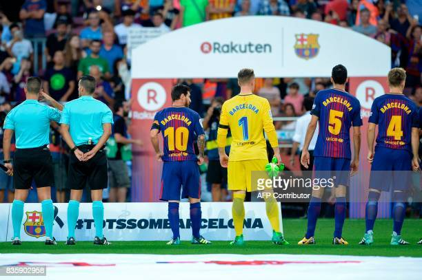 Barcelona's Argentinian forward Lionel Messi Barcelona's German goalkeeper MarcAndre Ter Stegen and teammates stands with their jersey reading...