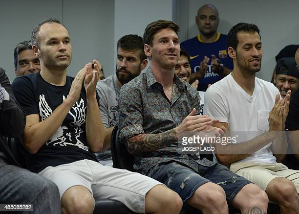 Barcelona's Argentinian forward Lionel Messi Barcelona's midfielder Andres Iniesta and Barcelona's midfielder Sergio Busquets clap during a farewell...