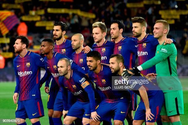 Barcelona's Argentinian forward Lionel Messi Barcelona's Portuguese defender Nelson Semedo Barcelona's Portuguese midfielder Andre Gomes Barcelona's...