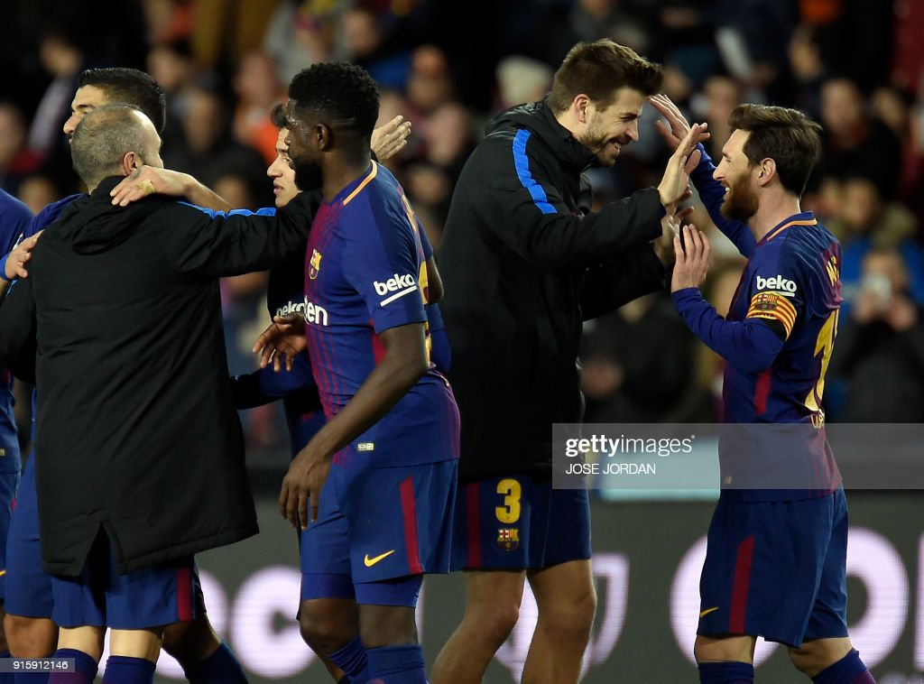 Barcelona's Argentinian forward Lionel Messi (R), Barcelona's Spanish defender Gerard Pique (2R) and the rest of teammates celebrate their qualification for the final match during the Spanish 'Copa del Rey' (King's cup) second leg semi-final football match between Valencia CF and FC Barcelona at the Mestalla stadium in Valencia on February 8, 2018. /