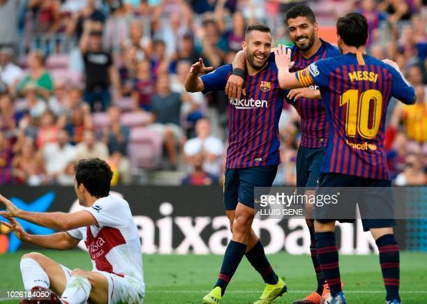 Barcelona's Argentinian forward Lionel Messi Barcelona's Uruguayan forward Luis Suarez and Barcelona's Spanish defender Jordi Alba celebrates...
