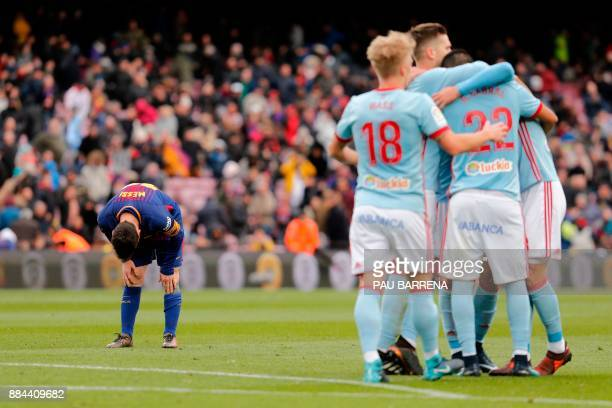 TOPSHOT Barcelona's Argentinian forward Lionel Messi bends at the end of the Spanish league football match FC Barcelona vs RC Celta at the Camp Nou...