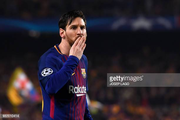 Barcelona's Argentinian forward Lionel Messi blows a kiss after scoring a goal during the UEFA Champions League round of sixteen second leg football...
