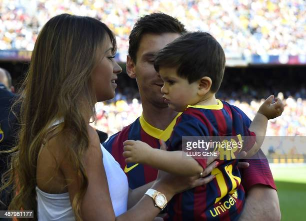 Barcelona's Argentinian forward Lionel Messi carries his son next to his wife Antonella before the Spanish league football match FC Barcelona vs...