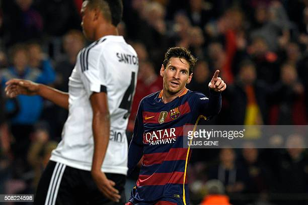 Barcelona's Argentinian forward Lionel Messi celebrates a goal during the Spanish Copa del Rey football match FC Barcelona vs Valencia CF at the Camp...