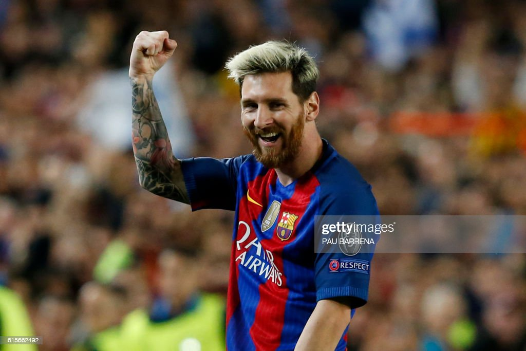 TOPSHOT - Barcelona's Argentinian forward Lionel Messi celebrates a goal during the UEFA Champions League football match FC Barcelona vs Manchester City at the Camp Nou stadium in Barcelona on October 19, 2016. /