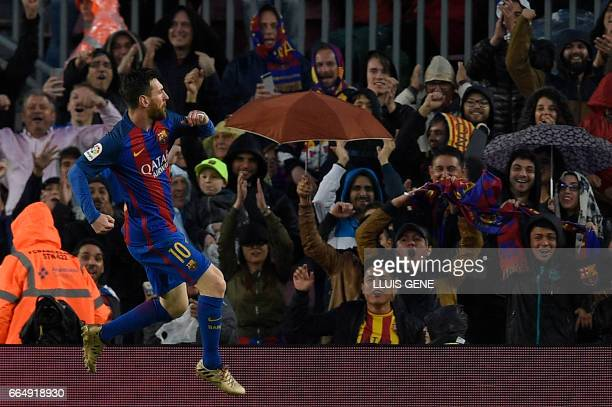 Barcelona's Argentinian forward Lionel Messi celebrates a goal during the Spanish league football match FC Barcelona vs Sevilla FC at the Camp Nou...