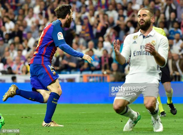 Barcelona's Argentinian forward Lionel Messi celebrates a goal during the Spanish league football match Real Madrid CF vs FC Barcelona at the...