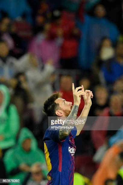 Barcelona's Argentinian forward Lionel Messi celebrates a goal during the UEFA Champions League group D football match FC Barcelona vs Olympiacos FC...