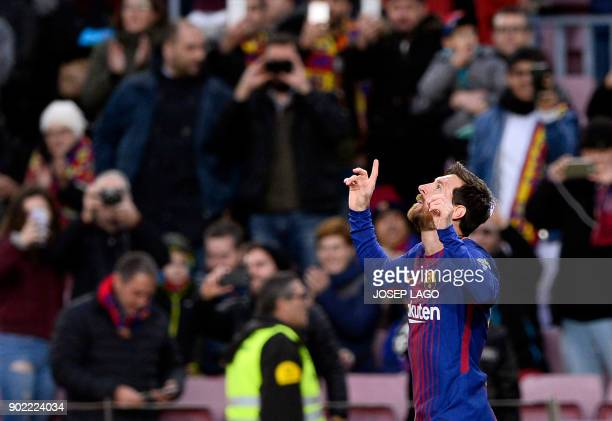 Barcelona's Argentinian forward Lionel Messi celebrates a goal during the Spanish league football match FC Barcelona vs Levante UD at the Camp Nou...