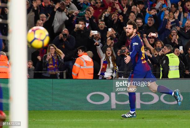 TOPSHOT Barcelona's Argentinian forward Lionel Messi celebrates a goal during the Spanish league football match between FC Barcelona and Deportivo...