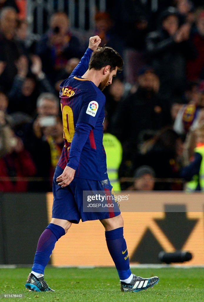 Barcelona's Argentinian forward Lionel Messi celebrates a goal during the Spanish league football match between FC Barcelona and Deportivo Alaves at the Camp Nou stadium in Barcelona on January 28, 2018. / AFP PHOTO / Josep LAGO