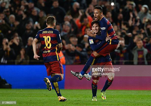 TOPSHOT Barcelona's Argentinian forward Lionel Messi celebrates a goal with teammate Barcelona's Brazilian forward Neymar as Barcelona's defender...