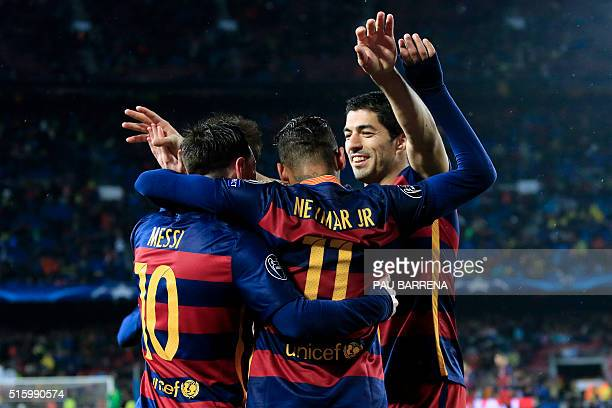 TOPSHOT Barcelona's Argentinian forward Lionel Messi celebrates a goal with Barcelona's Uruguayan forward Luis Suarez and Barcelona's Brazilian...