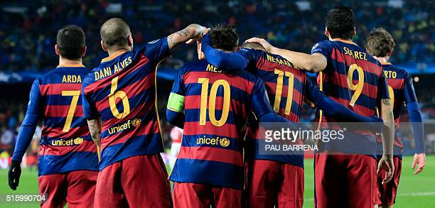 Barcelona's Argentinian forward Lionel Messi celebrates a goal with teammates during the UEFA Champions League Round of 16 second leg football match...