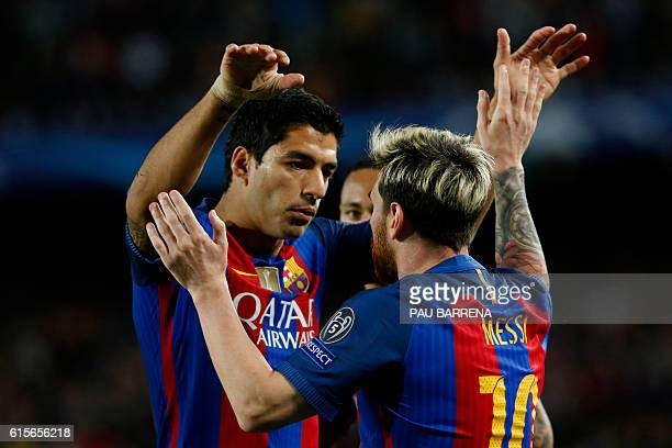 Barcelona's Argentinian forward Lionel Messi celebrates a goal with Barcelona's Uruguayan forward Luis Suarez during the UEFA Champions League...