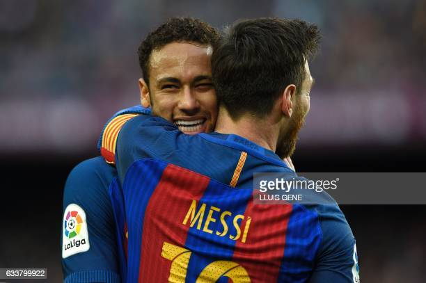Barcelona's Argentinian forward Lionel Messi celebrates a goal with Barcelona's Brazilian forward Neymar during the Spanish league football match FC...