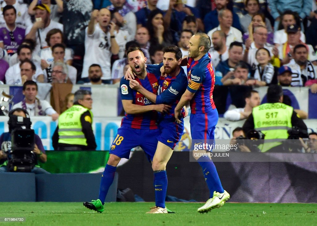 Barcelona's Argentinian forward Lionel Messi (C) celebrates a goal with Barcelona's defender Jordi Alba (L) and Barcelona's midfielder Andres Iniesta during the Spanish league football match Real Madrid CF vs FC Barcelona at the Santiago Bernabeu stadium in Madrid on April 23, 2017. /